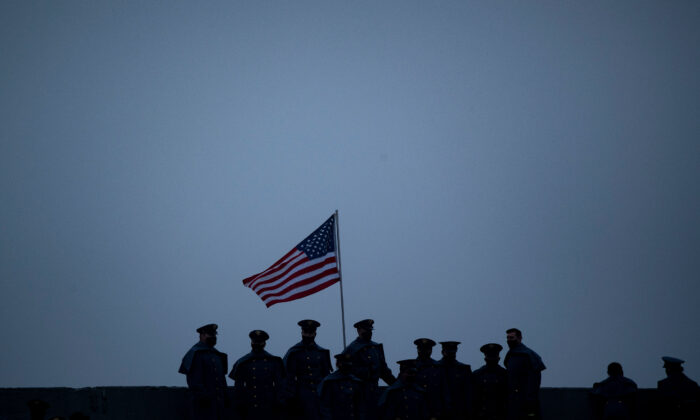 Members of the military stand near the U.S. national flag during the Army-Navy football game at Michie Stadium in West Point, New York, on Dec. 12, 2020. (Brendan Smialowski/AFP via Getty Images)