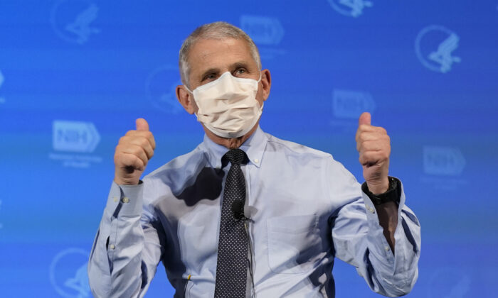 Dr. Anthony Fauci, director of the National Institute of Allergy and Infectious Diseases, gestures after receiving a COVID-19 vaccine, at the National Institutes of Health in Bethesda, Md., on Dec. 22, 2020. (Patrick Semansky/Pool/AFP via Getty Images)
