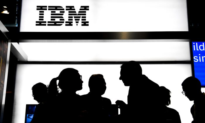 People talk at the stand of the US multinational information technology company International Business Machines Corporation (IBM), during the Vivatech startups and innovation fair, in Paris on May 16, 2019. (Alain Jocard/AFP via Getty Images)