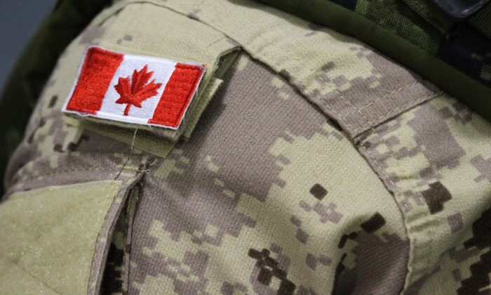 A Canadian flag sits on a member of the Canadian Armed Forces in this file photo. (The Canadian Press/Lars Hagberg)
