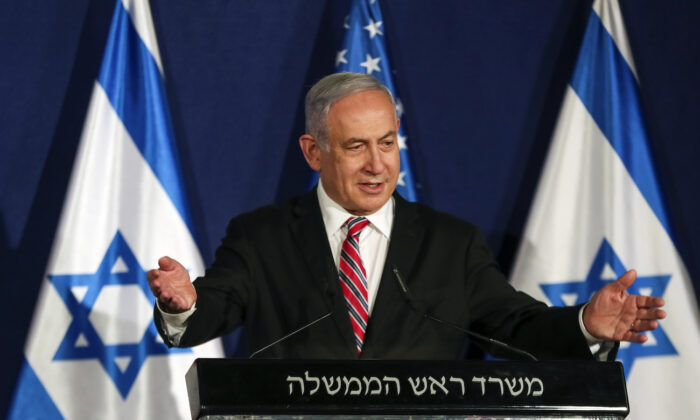 Israeli Prime Minister Benjamin Netanyahu speaks during a news conference with White House senior adviser Jared Kushner (not pictured), in Jerusalem, Israel, on Dec. 21, 2020. (Ronen Zvulun/Pool/Reuters)