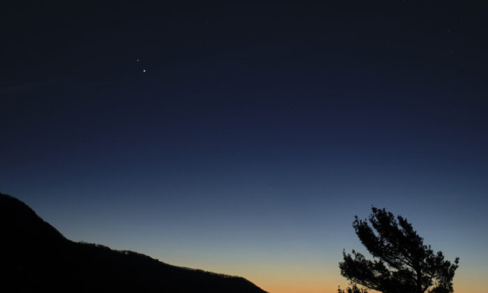 """Saturn, top, and Jupiter, below, are seen after sunset from Shenandoah National Park, Sunday, Dec. 13, 2020, in Luray, Virginia. The two planets are drawing closer to each other in the sky as they head towards a """"great conjunction"""" on December 21, where the two giant planets will appear a tenth of a degree apart. (NASA/Bill Ingalls)"""
