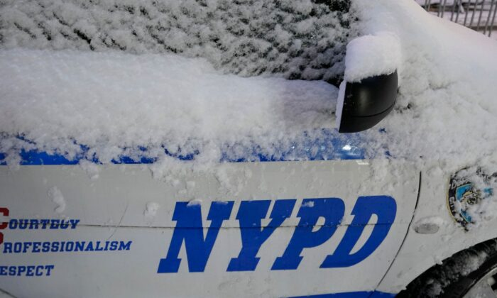 A NYPD police car is seen in the snow in New York, on Dec. 17, 2020. (Timothy A. Clary/AFP via Getty Images)