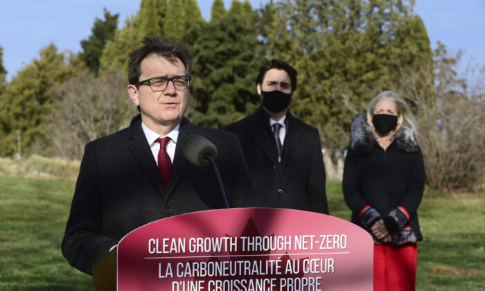 Minister of Environment and Climate Change Jonathan Wilkinson (L), Prime Minister Justin Trudeau, and Minister of Infrastructure and Communities Catherine McKenna hold a press conference at the Ornamental Gardens in Ottawa on Nov. 19, 2020. (The Canadian Press/Sean Kilpatrick)