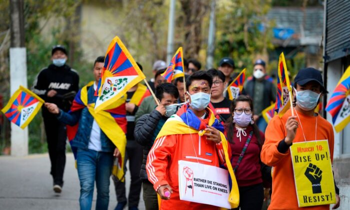 Tibetans living in exile take part in a protest march from McLeod Ganj to Dharamshala to mark the 61st anniversary of the Tibetan Uprising Day that commemorates the 1959 Tibetan uprising, in McLeod Ganj, India on March 10, 2020. (Sajjad Hussain/AFP via Getty Images)