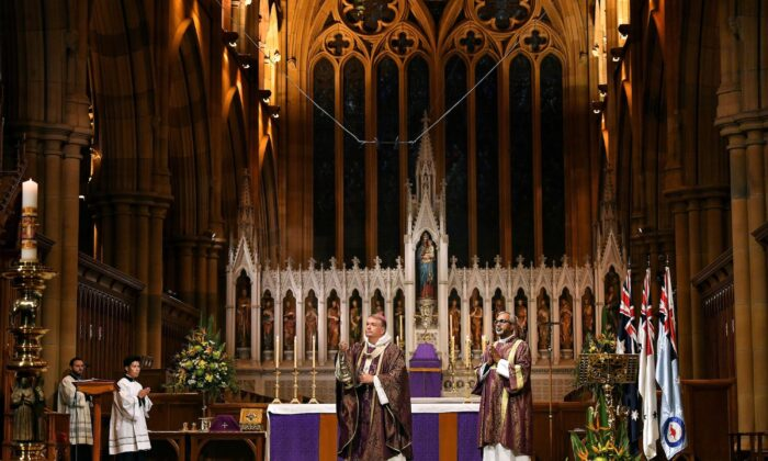 Catholic Archbishop Anthony Fisher (C) leads a mass on the eve of Anzac Day at St Mary's Cathedral in Sydney on April 24, 2020. (Saeed KHAN / AFP via Getty Images)