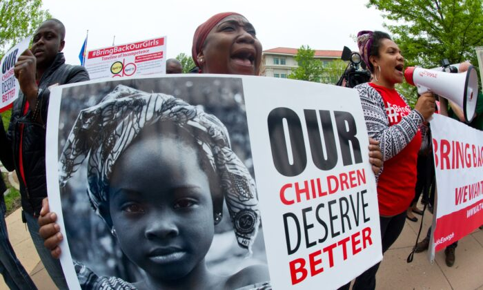 Demonstrators protest regarding the kidnapping of 276 girls by terror group Boko Haram in front of the Embassy of Nigeria in Washington on May 14, 2014. (Karen Bleier/AFP via Getty Images)