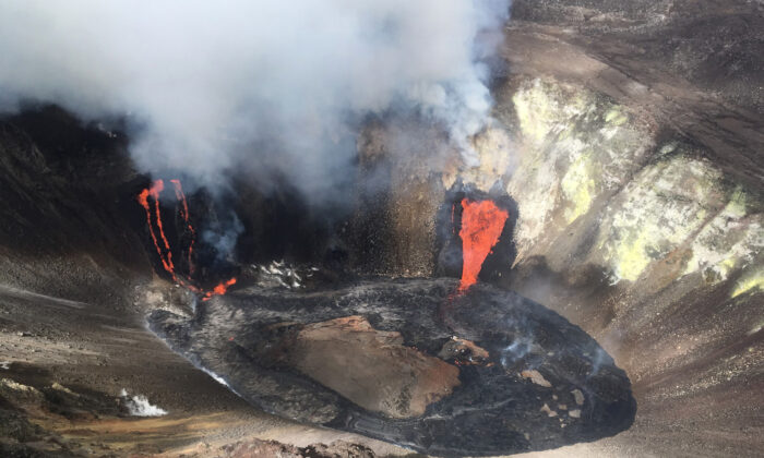 A plume rises near active fissures in the crater of Kilauea volcano in Hawaii on Dec. 21, 2020. (M. Patrick/U.S. Geological Survey via AP)