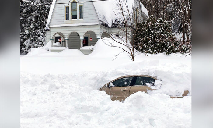 This photo, provided by the New York State Police, shows a car, in Owego, N.Y., from which a New York State Police sergeant rescued the 58-year-old Candor man stranded for 10 hours, covered by nearly 4 feet of snow. (New York State Police via AP)