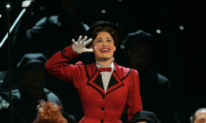 "Rebecca Luker, background, leads a performance of songs from ""Mary Poppins"" at the 61st Annual Tony Awards in New York on June 10, 2007.  (Jeff Christensen/AP Photo File)"
