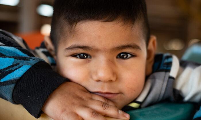 A child at Casas De Dios foster home, in Tijuana, Mexico, on Dec. 19, 2020. (John Fredricks/The Epoch Times)