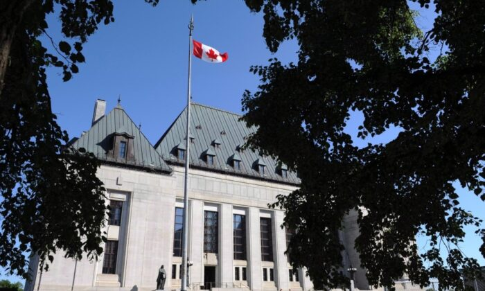 The Supreme Court of Canada in Ottawa on July 10, 2012. An Alberta woman who was granted a new trial by the Supreme Court of Canada has pleaded guilty to manslaughter in the fatal shooting of her domestic partner. (The Canadian Press/Sean Kilpatrick)