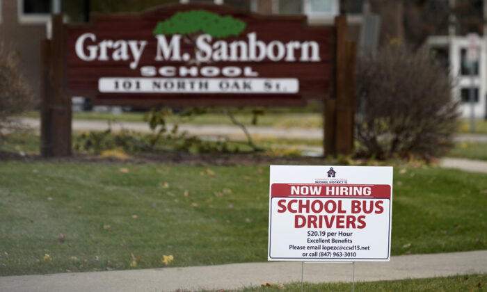 A hiring sign shows outside of Gray M. Sanborn Elementary School in Palatine, Ill., Nov. 5, 2020. (Nam Y. Huh/AP Photo)