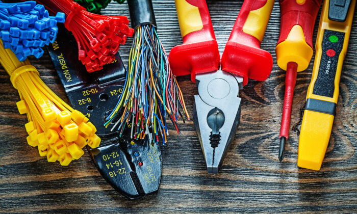 Remember that you are liable for any electrical work you do for as long as it exists. (mihalec/Shutterstock)