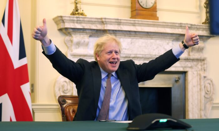 British Prime Minister Boris Johnson celebrates after reaching a deal with the EU on post-Brexit trade relations, in Downing Street, London, on Dec. 24, 2020. (UK Prime Minister's Office)