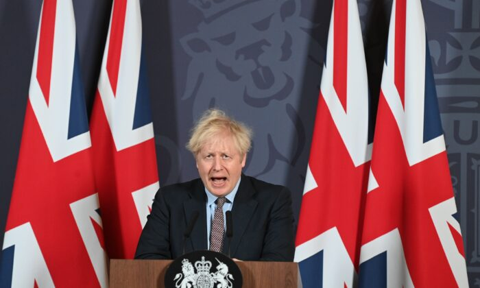 Prime Minister Boris Johnson holds a press conference on reaching a Brexit trade deal in Downing Street, in London, on Dec. 24, 2020. (Paul Grover - WPA Pool/Getty Images)