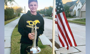 Teen Honors Fallen Marine by Playing Patriotic Hymns Outside Home for 2 Weeks