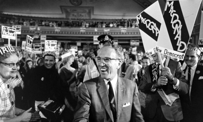 Tommy Douglas is surrounded by supporters as he arrives at the Palace Theatre to address an NDP rally in Hamilton, Ont., on June 11, 1968. (The Canadian Press)