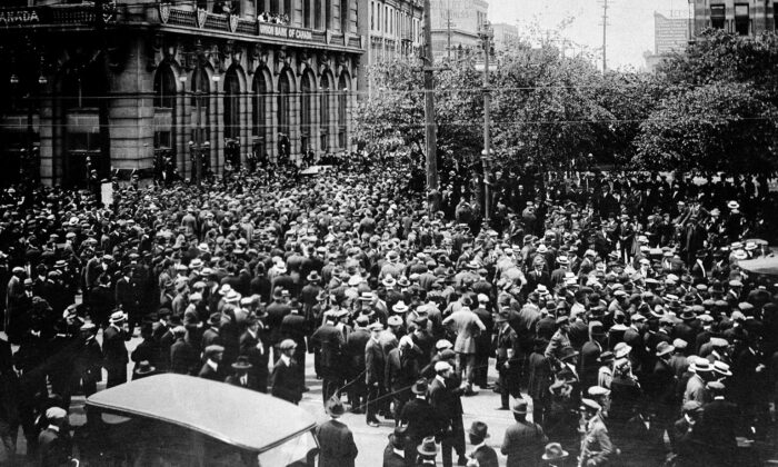 A crowd gathers outside the Union Bank of Canada building on Main Street during the Winnipeg General Strike on June 21, 1919. The six-week strike of more than 30,000 workers brought economic activity to a standstill in Winnipeg, at the time Canada's third-largest city. (The Canadian Press/National Archives of Canada)