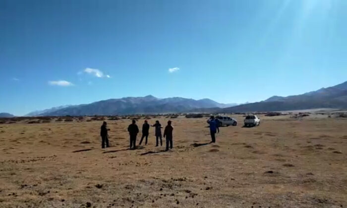 Screenshot of a video going viral in Ladakh shows a Chinese (two vehicles inset) incursion on the Cakzung pastures in Indian territory on Dec. 16. The Chinese retreated after being confronted by Indian officials. (Video courtesy Kunchok Stanzin)