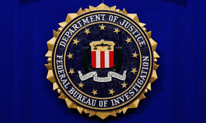 "The Federal Bureau of Investigation (FBI) seal is seen on the lectern following a press conference announcing the FBI's 499th and 500th additions to the ""Ten Most Wanted Fugitives"" list on June 17, 2013 at the Newseum in Washington, DC. (Mandel Ngan/AFP via Getty Images)"