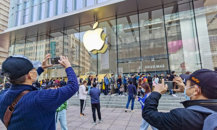 Customers line up to get their reserved iPhone 12 mobile phones at an Apple store in Shanghai on Oct. 23, 2020. (STR/AFP via Getty Images)