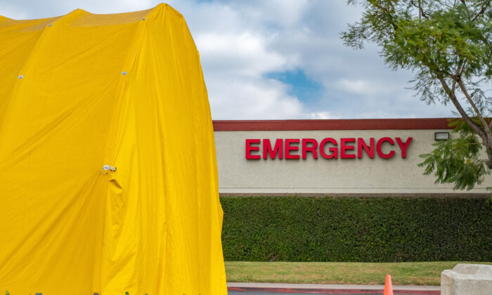 An emergency tent is set up outside of South Coast Global Medical Center in Santa Ana, Calif., on Dec. 11, 2020. (John Fredricks/The Epoch Times)