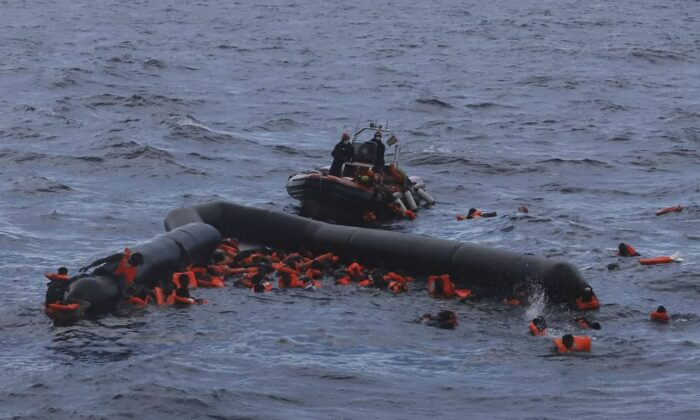 Refugees and migrants are rescued by members of the Spanish NGO Proactiva Open Arms, after leaving Libya trying to reach European soil aboard an overcrowded rubber boat in the Mediterranean sea. On Dec. 24, 2020. (AP Photo/file/Sergi Camara)