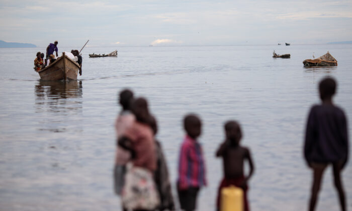 Refugees from Tchomia in the Democratic Republic of Congo arrive on boat at the Nsonga landing site on Lake Albert in Nsonga, Uganda, on April 9, 2018. (Jack Taylor/Getty Images)