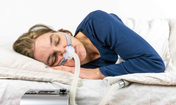A positive airway pressure (PAP) device helps those suffering sleep apnea get a better night's rest. (Per-Boge/Shutterstock)