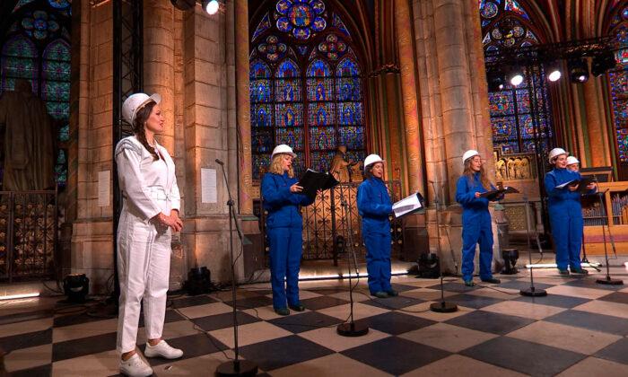 Soprani singer Julie Fuchs and the Notre Dame Cathedral choir recording a Christmas concert inside Notre Dame Cathedral in Paris, on Dec. 19, 2020. (MSNDP/Musique Sacree à Notre-Dame de Paris via AP)