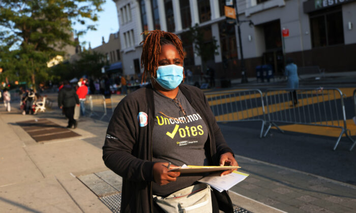 Natasha Cherry-Perez, senior associate director of community engagement with Uncommon Schools, walks the streets as she helps people register to vote on Sept. 22, 2020, in the Crown Heights neighborhood of Brooklyn. (Michael M. Santiago/Getty Images)