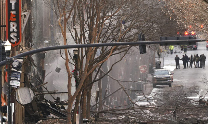 Emergency personnel work at the scene of an explosion in downtown Nashville, Tenn., on Dec. 25, 2020. (Mark Humphrey/AP Photo)