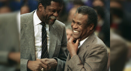 Former Boston Celtics teammates Bill Russell, Sacramento Kings coach, left, and K.C. Jones, Celtics coach, meet before the start of the Kings-Celtics NBA basketball game at the Boston Garden in Boston on Jan. 15, 1988.(Mike Kullen, File/AP)