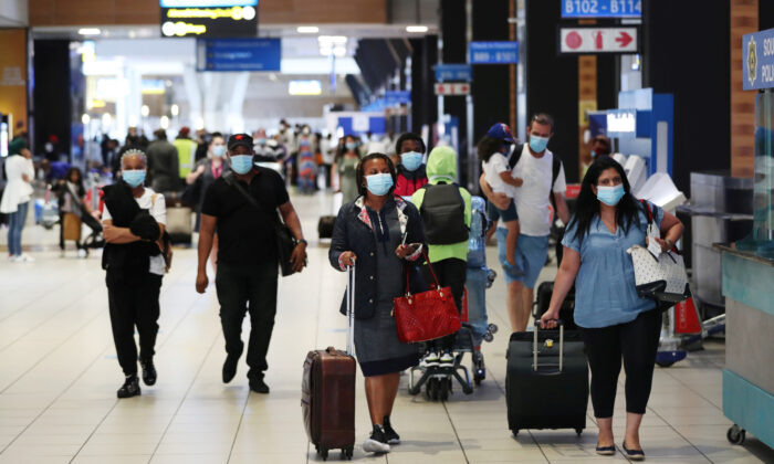 Passengers wearing protective masks walk to the check-in counters at the O.R. Tambo International Airport in Johannesburg, South Africa, on Dec. 22, 2020. (Siphiwe Sibeko/Reuters)
