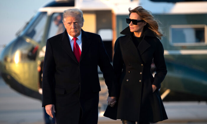 U.S. President Donald Trump and First Lady Melania Trump walk to board Air Force One prior to departure from Joint Base Andrews in Maryland as they travel to Mar-a-lago for Christmas and New Year's on Dec. 23, 2020. (SAUL LOEB/AFP via Getty Images)