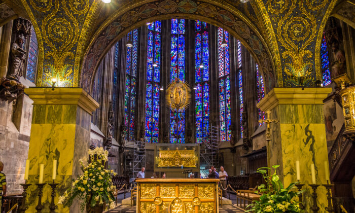 """Aachen Cathedral's Palatine Chapel was commissioned by Charlemagne in the late eighth century. In the center of this photo is the """"Radiant Madonna"""" by 15th-century Netherlandish sculptor Jan van Steffeswert. (Takashi Images/Shutterstock.com)"""