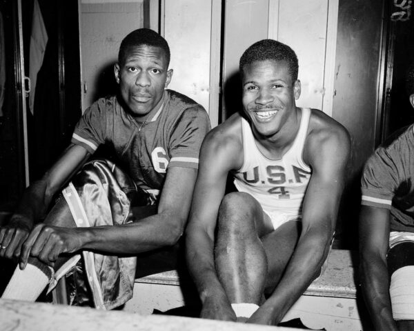 K.C. Jones, captain of the University of San Francisco Dons, right, is shown with teammate Bill Russell