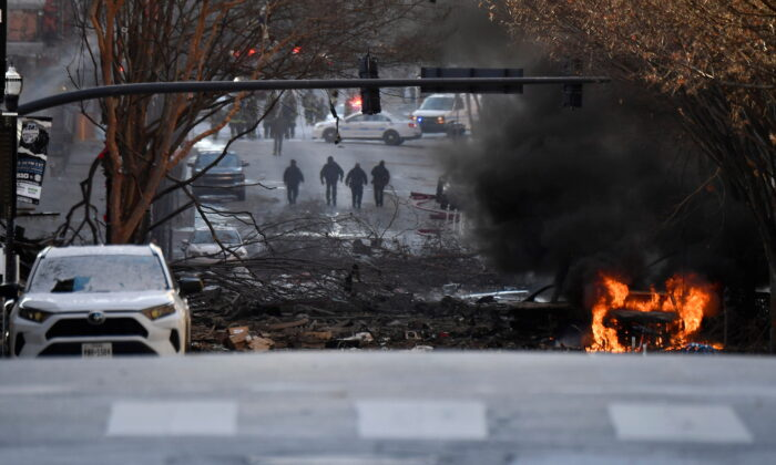 A vehicle burns near the site of an explosion in the area of Second and Commerce in Nashville, Tenn. on Dec. 25, 2020. (Andrew Nelles/Tennessean.com/USA TODAY NETWORK via REUTERS)