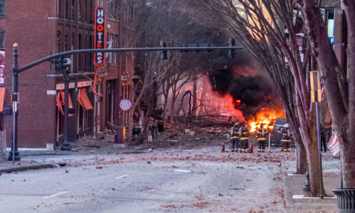 Debris litters the road near the site of an explosion in the area of Second and Commerce in Nashville, Tenn., on Dec. 25, 2020. (Elliott Anderson/Tennessean.com/USA Today via Reuters)