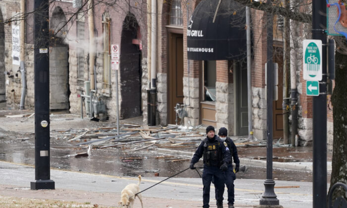 A K-9 team works in the area of an explosion in downtown Nashville, Tenn., on Dec. 25, 2020. (Mark Humphrey/AP Photo)