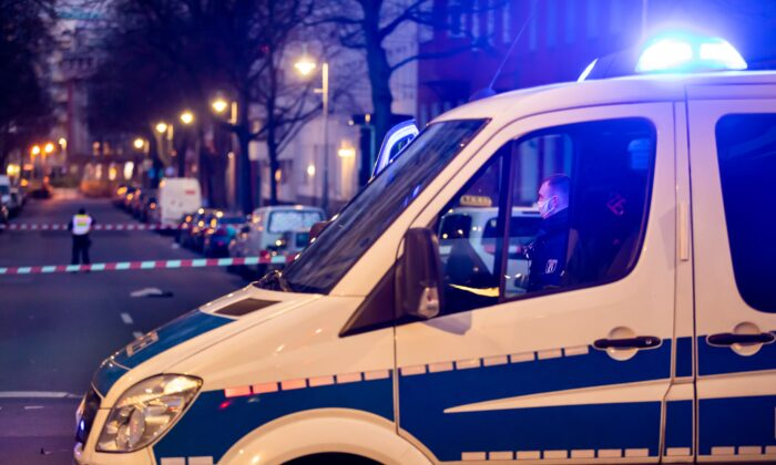 Policemen work at a crime scene in Berlin's Kreuzberg district on Dec. 26, 2020, following a shooting that left four people injured. (Odd Andersen/AFP via Getty Images)