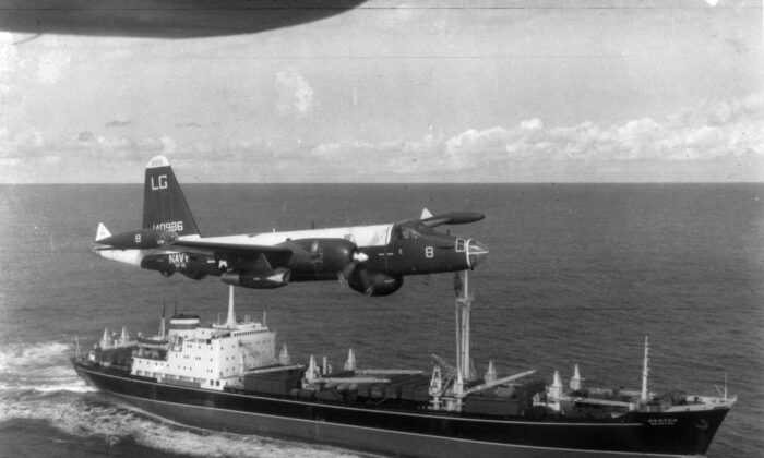 A U.S. patrol plane flies over a Soviet freighter during the Cuban missile crisis at the height of the Cold War in this 1962 photograph. (Getty Images)