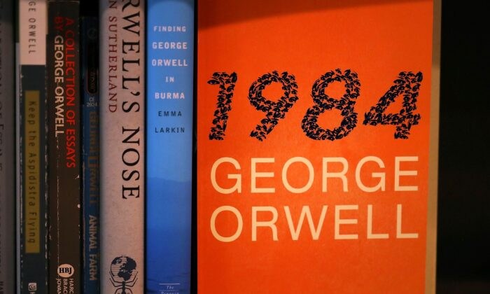 "A copy of George Orwell's ""1984"" at a bookstore in a file photo. To prevent cheating while writing an exam, students studying at home due to the pandemic are forced to install software on their computers that monitors every keystroke they make, bringing to mind Orwell's dystopian novel. (Justin Sullivan/Getty Images)"