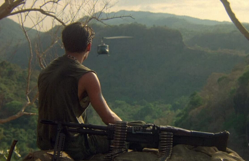 "man sitting with machine gun and helicopter in ""Platoon"""