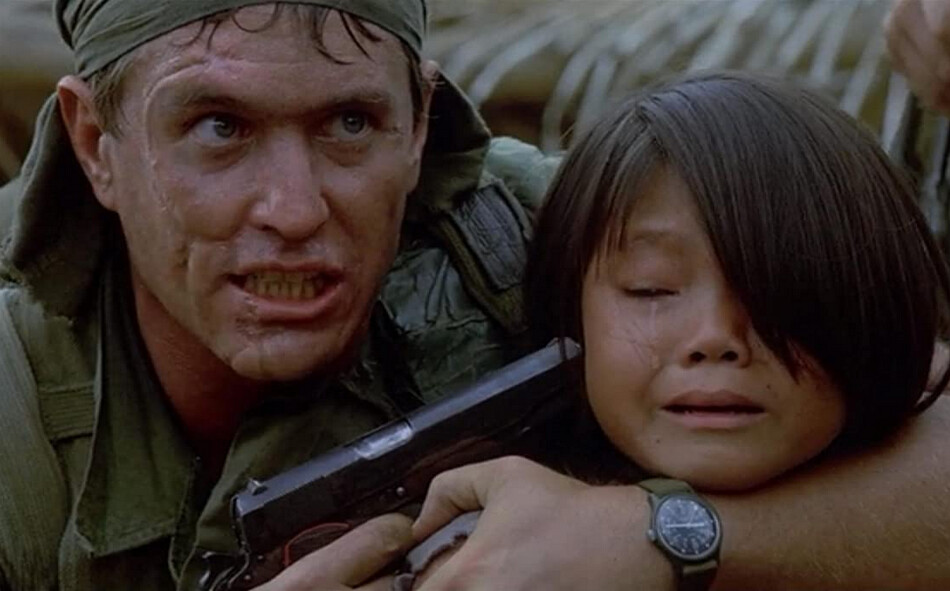"man holds pistol to young girl's head in ""Platoon"""