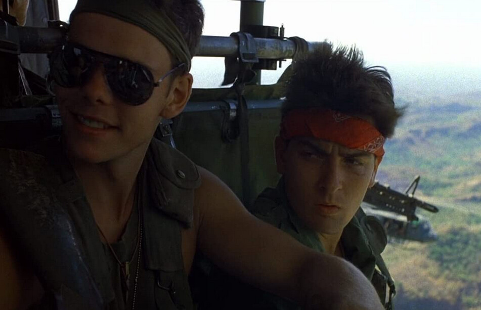 "two soldiers on a helicopter in ""Platoon"""