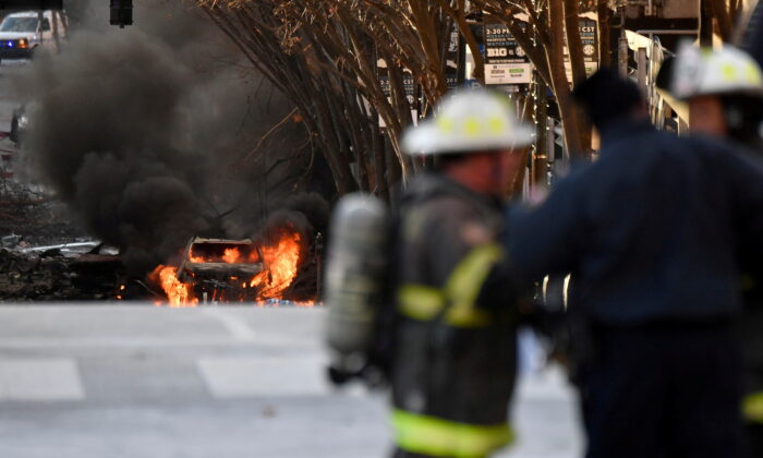 A vehicle burns near the site of an explosion in the area of Second and Commerce in Nashville Nashville, Tenn., on Dec. 25, 2020. (Andrew Nelles/Tennessean.com/USA Today Network via Reuters)