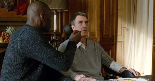 black man feeding white parapaligic