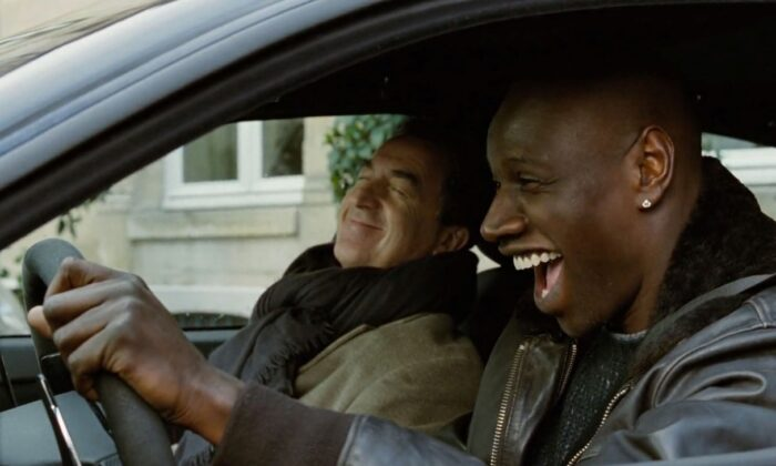 """Philippe (François Cluzet) and Griss (Omar Sy) bond despite their differences, in """"The Intouchables."""" (The Weinstein Company)"""